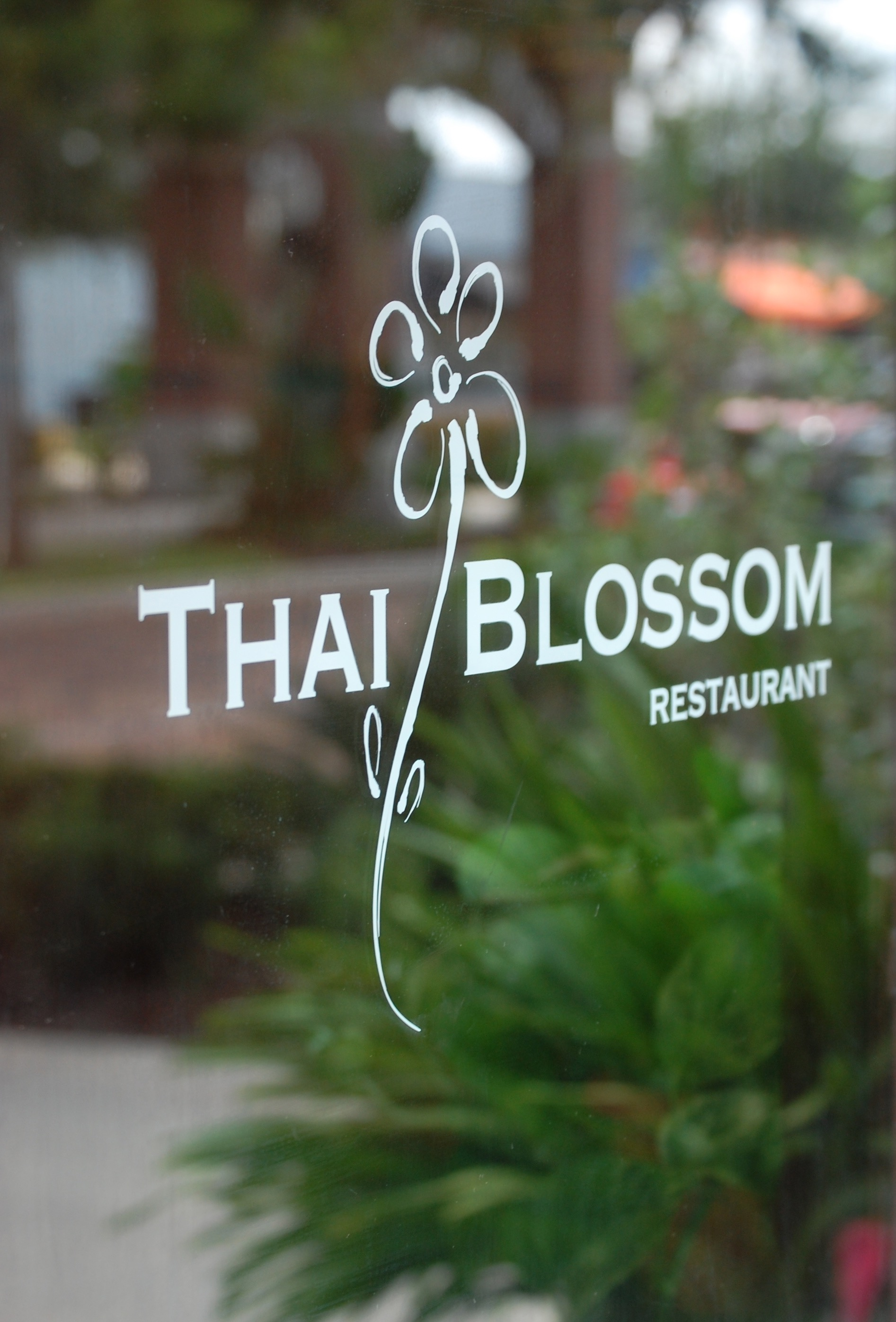 Front Door with Thai Blossom Logo Sticker