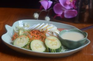 THAI BLOSSOM SALAD fresh lettuce, cucumber, tomatoes, onions, chicken and hard boiled eggs, served with our special thai dressing.
