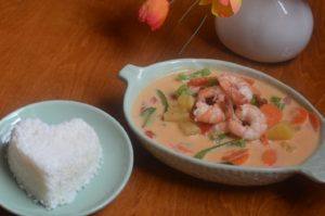 PINEAPPLE SHRIMP CURRY shrimp simmered with pineapple, tomatoes, bell pepper, carrots and sweet basil in our red curry.