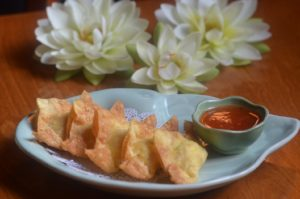KRAB RANGOON deep fried pastry filled with a blend of cream cheese and imitation crab meat.